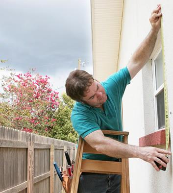 Home Inspector Measuring Window